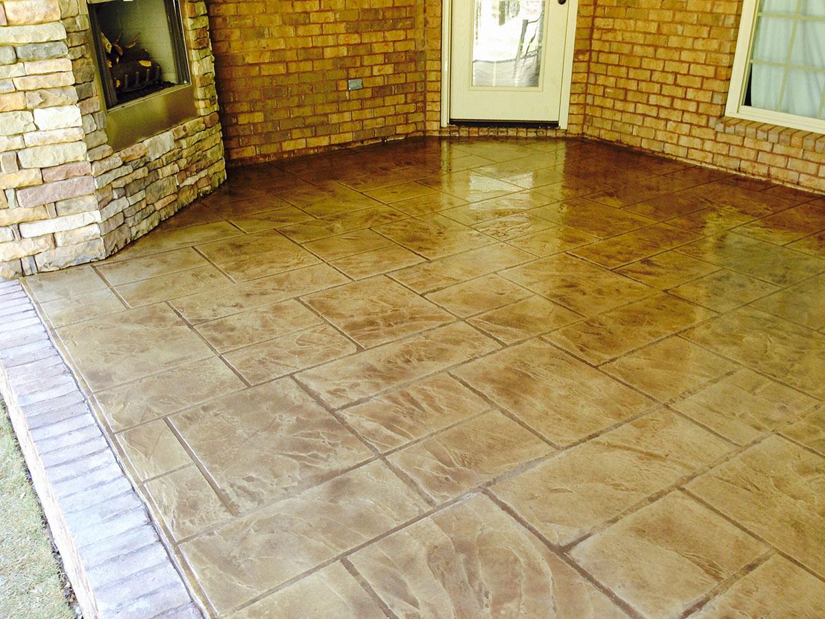 Antiqued-patio-with-brick-edging-2W - Decorative Concrete, Inc.