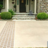 tan driveway with brick pattern stripe