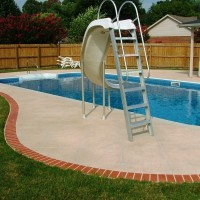 Pool deck brick edge with slide
