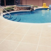PoolDecks_pool-with-rock-surround-hot-tubW